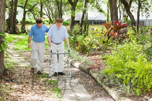 Male Caregiver caring for aging parents