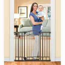 This tall granddog and grandkid gate has a door that opens so you can get through it more easily