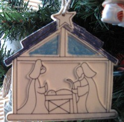 Heres a wooden Nativity Christmas tree ornament that one of my grandchildren colored for me