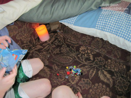 Recipe for a perfect rainy day - a fort, old and new legos, battery operated lights and pillar candles, and sweet little grandchildren