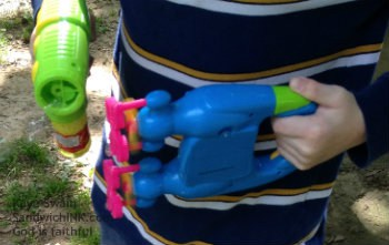 Both were fun but for our Sandwich Generation family, the bubble shooter guns with the bottles won the day