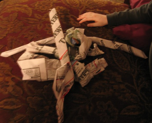 Making newspaper knots for the woodstove