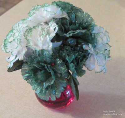 Easy St Patricks Day and March crafts for kids seniors and boomers include lovely little green and white nosegays in a red vase my grandkids gave me
