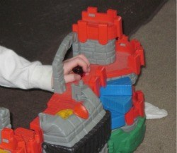 This grandson was busy playing with a castle AND watching Cyberchase - multitasking at 7
