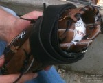 At the end of the process of how to break in a baseball glove - you wrap it with a belt with the baseball inside the mitt