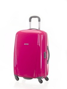 Love this hot pink travel luggage on wheels - would definitely be easy to spot