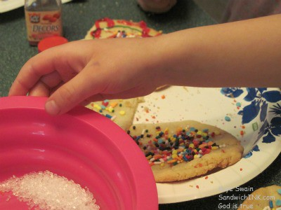One tip for how to make sugar cookies with grandkids - pour some of the sprinkles into a bowl - then they have some left over for future cookie decorating projects