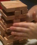 The Sandwich Generation granny nanny and grandson enjoyed a jenga game for happy grandparents day activities