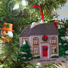 The Sandwich Generation granny nanny loves personalized Christmas tree ornaments including this delightful one from the caregiving holiday progressive blog party photographed with my easy to use digital camera
