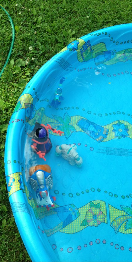 My grandkids love to grab some of their planet hero people to play with in the plastic wading pool