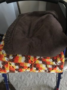 walker dementia patients use could turn into blanket and hanger holder